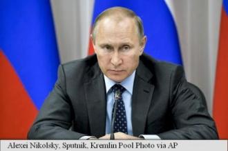 Putin anunță reducerea cheltuielilor pentru apărare în 2018