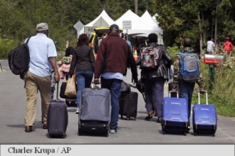 Migranți intrați în Canada pentru a depune legal cereri de azil au fost retrimiși în SUA