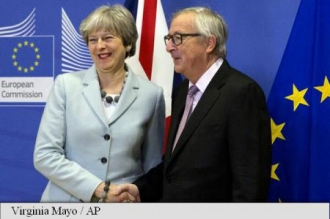 May în drum spre Bruxelles pentru a se întâlni cu Juncker