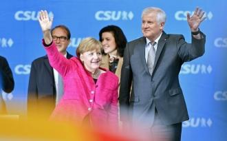 Social-democraţii germani aprobă noul acord de coaliţie guvernamentală cu formaţiunea condusă de Angela Merkel