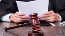 Un executor judecătoresc și un evaluator au fost trimiși în judecată pentru ...